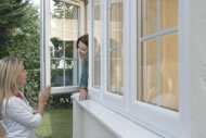 Woman talking through Deceuninck Upvc Windows